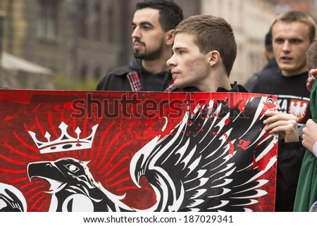 KRAKOW, POLAND - APR 13, 2014: Unidentified participants IV Procession Katyn in memory of all murdered in Apr 1940, more than 21,000 Polish prisoners from NKVD camps and prisons at behest of I.Stalin. - stock photo