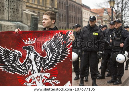 KRAKOW, POLAND - APR 13, 2014: Unidentified participants IV Procession Katyn in memory of all murdered in Apr 1940, more than 21,000 Polish prisoners from NKVD camps and prisons at behest of I. Stalin. - stock photo