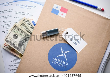 KRAKOW, POLAND - APRIL 5, 2016 : Folder with Mossack Fonseca logo and printed documents from it's web site, US and EU currency, flash drive.  - stock photo