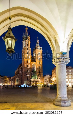 Krakow - Poland - April 22. Krakow  - Church of Our Lady Assumed into Heaven or St. Mary's Church. Night picture. Highlighted Church and Cloth Hall. Krakow - Poland - April 2015. - stock photo