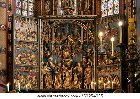Krakow, Poland - August 13, 2011: Interior of the St. Mary's Basilica. In front of  the largest Gothic altarpiece in the World - The Altarpiece of Veit Stoss made  in the years 1477-1489.  - stock photo