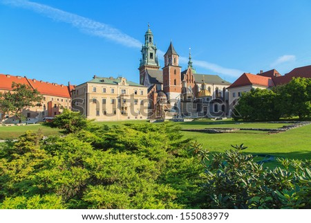 Krakow, Poland. Beautiful flowers near Wawel Castle with the blue sky in the background - stock photo