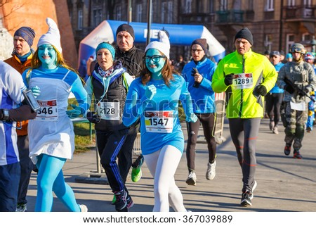 Krakow, Poland - December 31, 2015: 12th New Year's Eve Race in Krakow. The people running dressed in funny costumes - stock photo