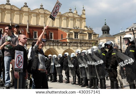 KRAKOW, POLAND - FEBRUARY 19,2009 : The participants of the manifestation of anti-NATO on the main square in Krakow.  - stock photo