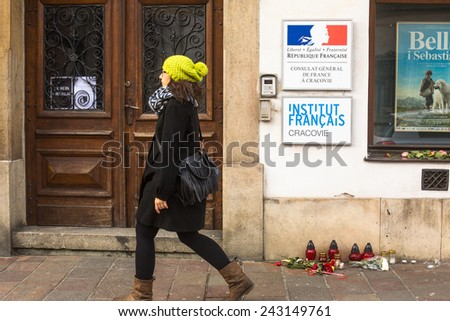KRAKOW, POLAND - JAN 11, 2015: Action near the facade of the Consulate General of France in Krakow solidarity for the victims of the Charlie Hebdo attacks in Paris. - stock photo
