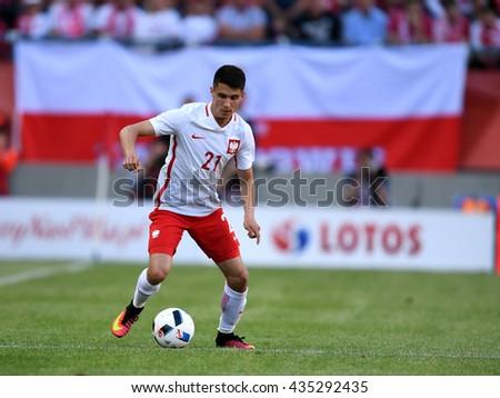 KRAKOW, POLAND - JUNE 06, 2015: EURO 2016 European International Friendly Game Poland - Lituania o/p  Bartosz Kapustka  - stock photo