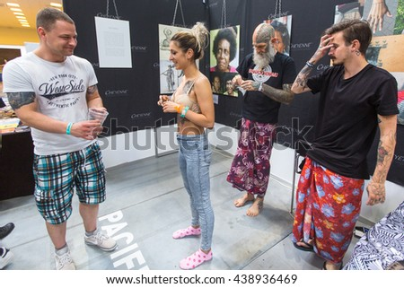 KRAKOW, POLAND - JUNE 12, 2016: Unidentified festival participants during the 11-th International Tattoo Convention in the Congress-EXPO Center of Krakow. - stock photo