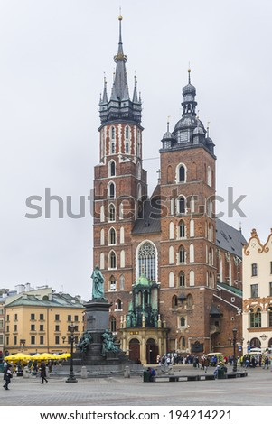 KRAKOW, POLAND - MARCH 5, 2014: View of Brick Gothic St. Mary's Basilica (Church of Our Lady Assumed into Heaven or Kosciol Mariacki). Built in early 13th century Church is main landmark of city.
