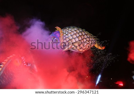 KRAKOW, POLAND - MAY 30, 2015: Yearly Great Dragons Parade connected with the fireworks display, taking place on the river Vistula at Wawel. Cracow , Poland - stock photo