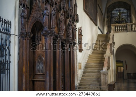 KRAKOW, POLAND - NOV 04, 2014: Holy Trinity Church. Ancient wooden statues in the church. Built in 1250 by Dominican friars from Bologna. Picture taken while traveling in Poland. - stock photo