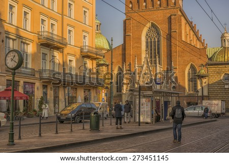 KRAKOW, POLAND - NOV 04, 2014: Holy Trinity Church. Built in 1250 by Dominican friars from Bologna. Place in front of the church. Architecture in the old town. Picture taken while traveling in Poland. - stock photo