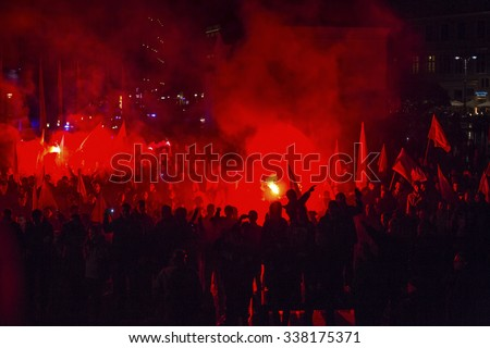 KRAKOW, POLAND - NOV 11, 2015: Protesters march through center of city. About 3.000 people took part in March of Free Poland. Participants chanted slogans Neither EU nor NATO, Poland only for Poles. - stock photo