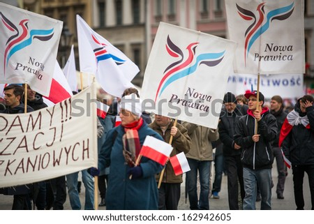"KRAKOW, POLAND - NOV 11: Unidentified participants celebrating National Independence Day, holds a poster ""New Right""(name one of Polish political party), Nov 11, 2013 in Krakow, Poland."