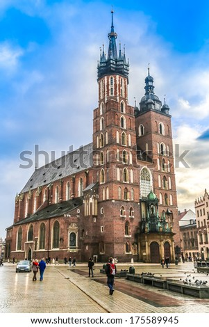 KRAKOW, POLAND - OCT 15: St. Mary's Church in historical center of Krakow, October 15, 2012 in Krakow, Poland. This year the city was visited by 8.1 million tourists.
