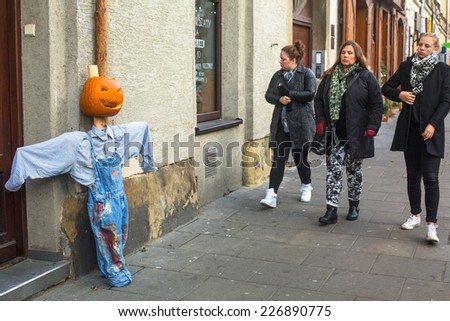 KRAKOW, POLAND - OCT 29, 2014: Unidentified townspeople and scenery for celebrating Halloween in Krakow. - stock photo