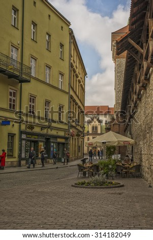 KRAKOW, POLAND - OCT 30, 2014: Walking tourists towards the center of the old town. Architecture in the old town. Picture taken during a trip to Krakow