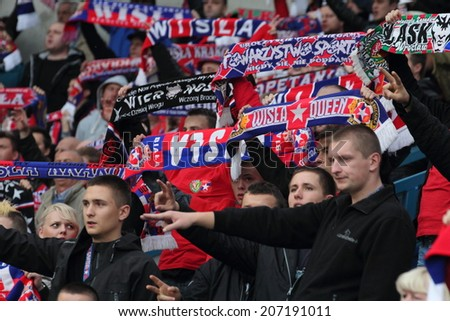 KRAKOW, POLAND - October 6: Wisla Krakow ultras (ultra supporters) during football match between Wisla Krakow and Legia Warsaw, on October 6, 2013 in Krakow, Poland.  - stock photo