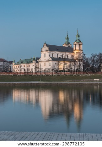 Krakow, Poland, scenic Vistula riverbank with Pauline fathers church in the evening
