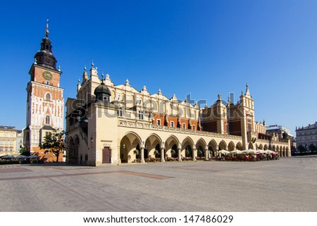 Krakow -   Sukiennice buidning with Town Hall in the background - stock photo