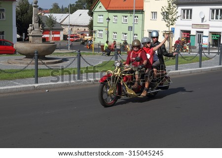 KRASNA LIPA, CZECH - AUGUST 29 2015: 17th year of the international meeting of unique vintage Cechie-Bohmerland motorcycles in Krasna Lipa. Photo from great motorcycle parade. Public-event.