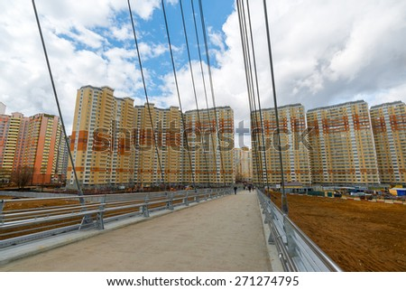 Krasnogorsk, RUSSIA - April 18,2015. Pedestrian bridge is built from two pylons, measuring 41 m tall. Pylons are connected to spans with help of 28 straight cable wires, which hold up suspension spans