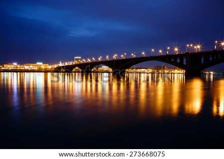 Krasnoyarsk, Russia - May 9, 2014: the bridge through the river Yenisei, a night view of the city of Krasnoyarsk