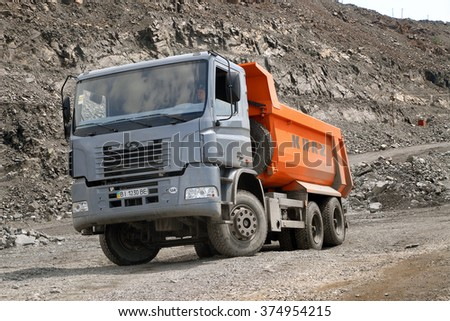 Kremenchug, Ukraine - June 26, 2010. Dump truck KrAZ stand on a road in a stone quarry. - stock photo