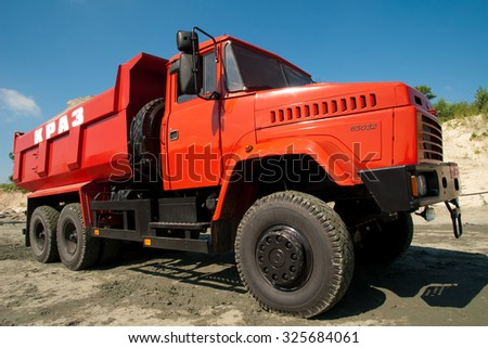 Kremenchug, Ukraine - 27 June 2008. Red dump truck driving on a road in a stone quarry