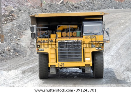 Kremenchug, Ukraine - 26 June 2010. Yellow dump truck Komatsu, driving on a road in a stone quarry - stock photo