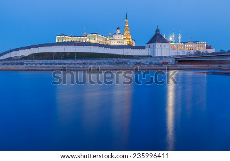 Kremlin illuminated by backlight by the river in the evening twilight. Kazan Kremlin, the Republic of Tatarstan, Russian Federation - stock photo