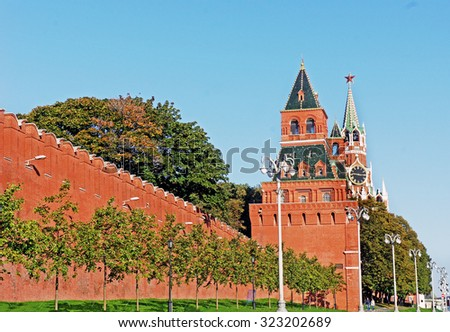Kremlin wall and Spasskaya Tower of Moscow Kremlin at Red Square in Moscow, Russia - stock photo