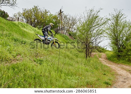 Kriviy Rig, Ukraine - MAY 6, 2015: Unknown rider participates at training , May 6, 2015 at Kriviy Rig, Ukraine - stock photo
