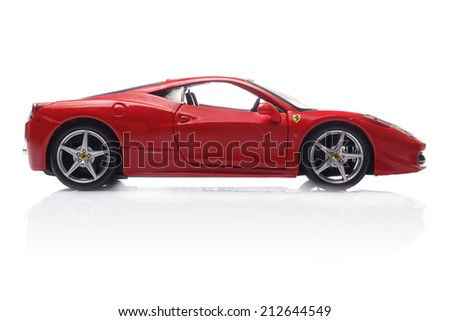 KRIVOY ROG, UKRAINE - AUG 22- Toy ferrari 458 Italia on white background, Friday 22 August 2014 - stock photo