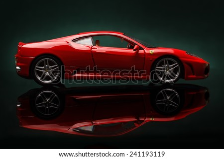 KRIVOY ROG, UKRAINE - DEC 25- Toy ferrari F430 on green background, Thursday 25 December 2014 - stock photo