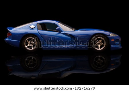 KRIVOY ROG, UKRAINE - JAN 04 - Toy blue dodge viper on black background, Saturday 4 January 2014 - stock photo