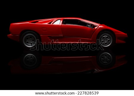 KRIVOY ROG, UKRAINE - OCT 26 - Toy lamborghini Diablo on black background, Sunday 26 October 2014 - stock photo