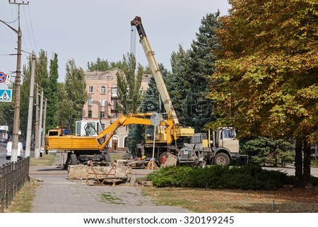 Krivoy Rog, Ukraine - September 22, 2015: Loader excavator and mobile crane.
