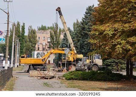 Krivoy Rog, Ukraine - September 22, 2015: Loader excavator and mobile crane. - stock photo