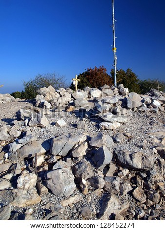 Krizevac stones near  of the apparitions of Our Lady in Medjugorje as a background