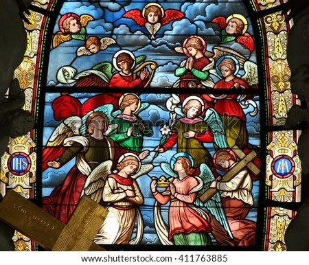 KROMERIZ, CZECH REPUBLIC - APRIL 22: Angels in heaven - stained glass in Church of the Assumption in town Kromeriz, Czech republic, on April 22, 2016.
