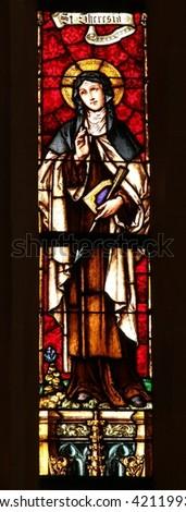 KROMERIZ, CZECH REPUBLIC - MAY 15: Saint Theresia of Avila - Stained glass in St. Moritz Church in town Kromeriz, Czech republic, on May 15, 2016. - stock photo