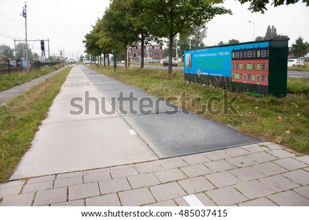 KROMMENIE - SEPTEMBER 17: First solar cycle lane in the world, created by SolaRoad company. Generates electric energy to power 3 houses. Photographed on September 17, 2016 in Krommenie, Netherlands.