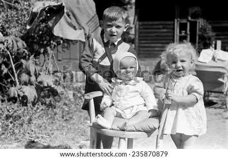 KROSNO,POLAND - CIRCA 1946 :vintage photo of children outdoor at spring