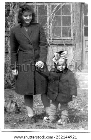 KROSNO,POLAND - CIRCA 1946 : vintage photo of mother with her small daughter