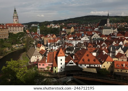 Krummau Castle and St Vitus Church over tiled roofs in Cesky Krumlov, South Bohemia, Czech Republic.  - stock photo