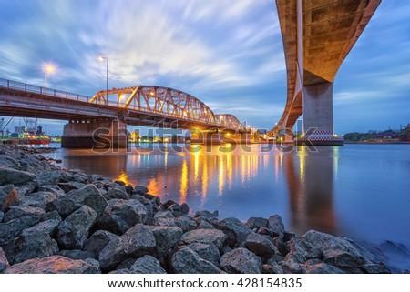 Krung Thep Bridge ( Bascule bridge) with Beautiful blue sky and night background ,Bangkok, Thailand. - stock photo