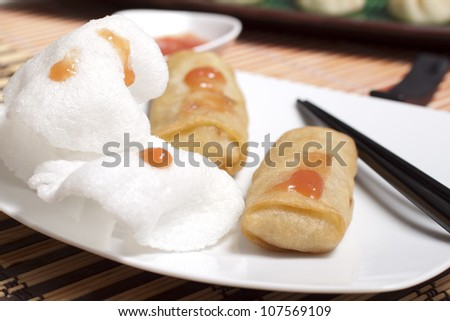 Krupuk udang with sweet and sour sauce - stock photo