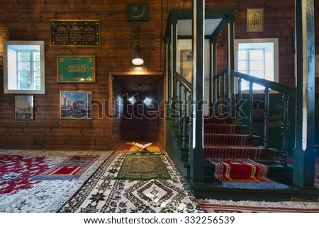 KRUSZYNIANY, POLAND - SEPTEMBER 30, 2015: Wooden tatar-mosque interior from the 18th century. The decorations and fixtures are mostly modern, but original woodwork decoration are preserved. - stock photo