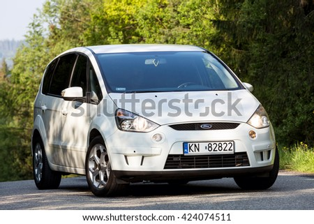 Krynica-Zdroj, POLAND - MAY 21, 2016: White Ford Focus S-MAX on the asphalt road. Popular Van for families with children and for holidays. - stock photo