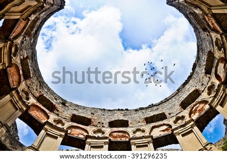 Krzyztopor (eng. Crossaxe) castle ruins in Ujazd village Poland. View of the main hall walls and sky (instead of the ceiling) - stock photo